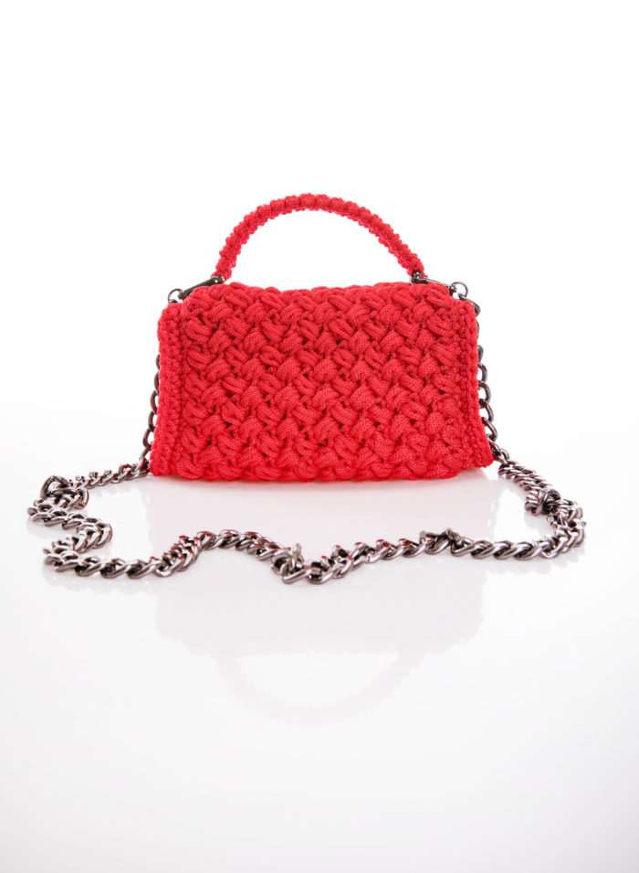 red handmade crochet flapbag in right side vew