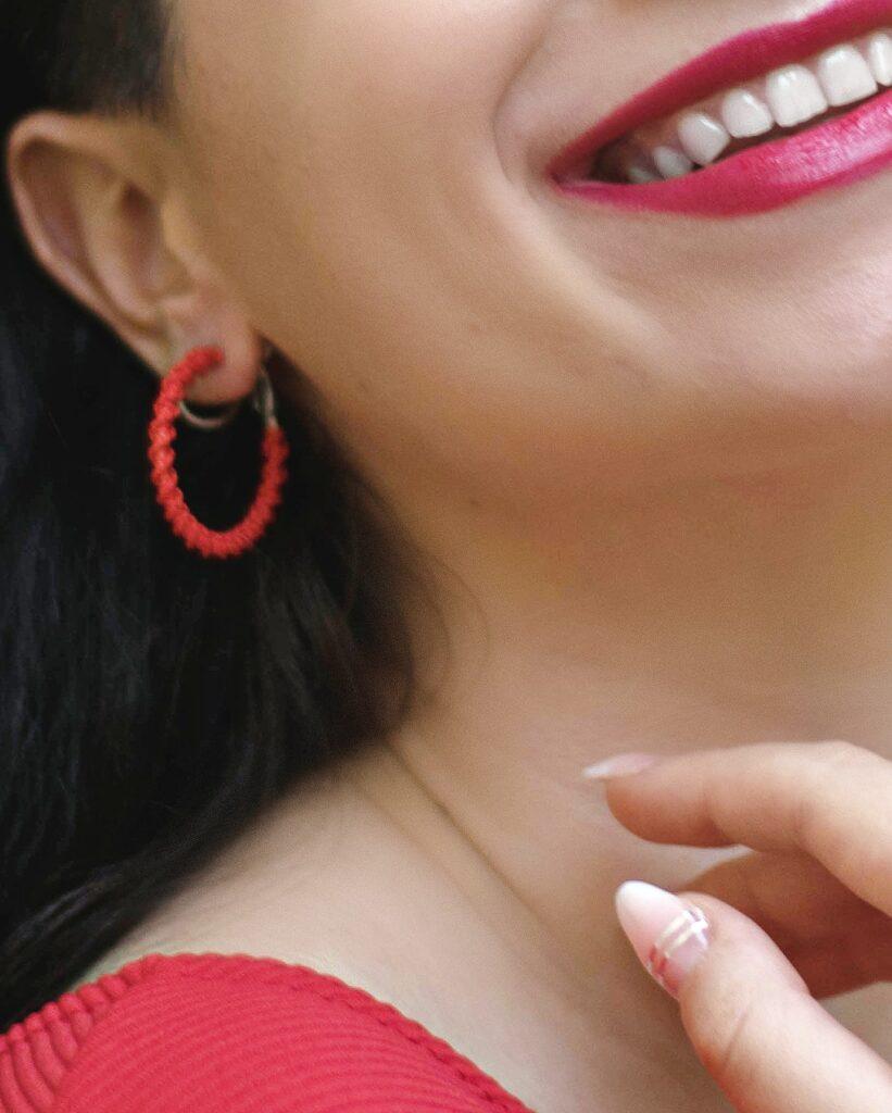 girl wears handmade macrame earring hoops