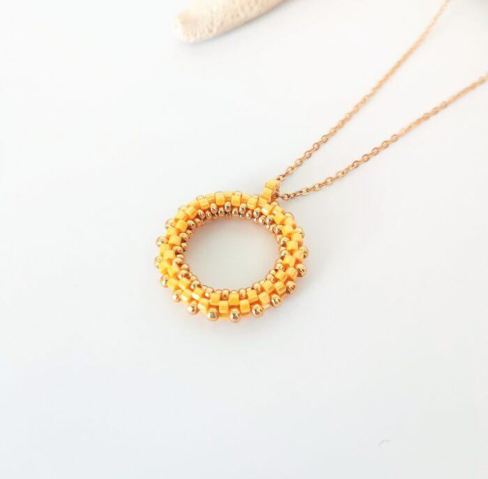 yellow beaded hoop pendant