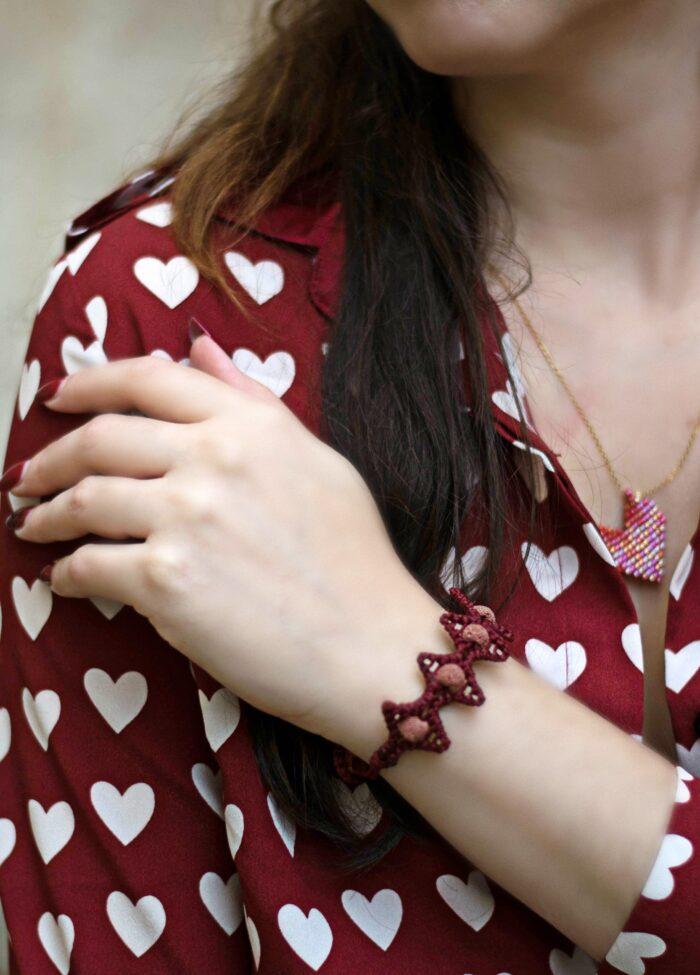 girl wears handmade lava stars macrame bracelet