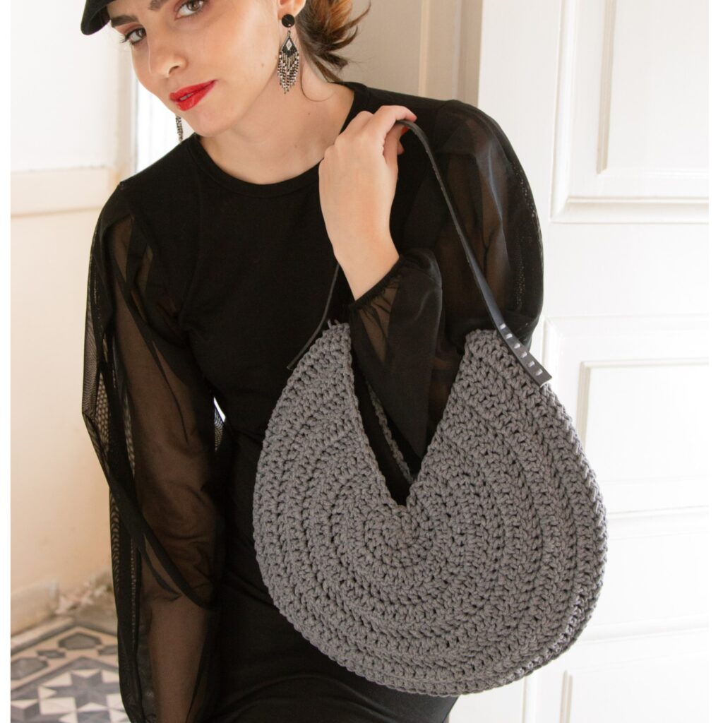black outfit with round bag