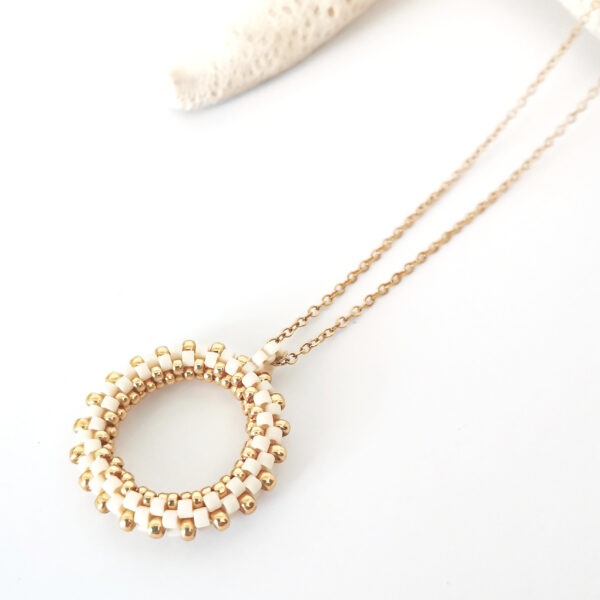 cream beaded hoop pendant